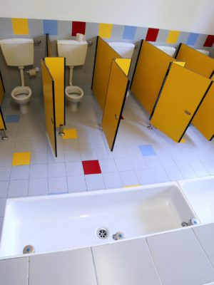 small ceramic toilets in the bathroom of the kindergarten